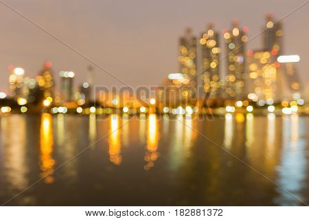 Night light blurred bokeh office building water front abstract background