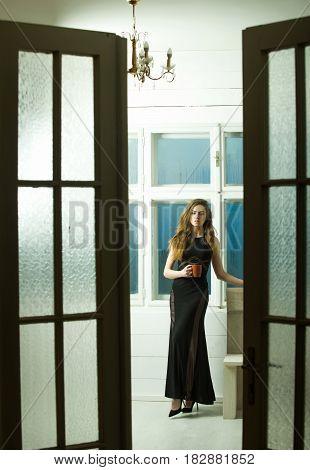 Pretty Girl In Black Dress Through Open Doors