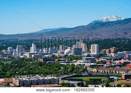 RENO - MAY 31: Reno skyline on May 31, 2016. It's known as The Biggest Little City in the World, famous for it's casinos and the birthplace of the gaming corporation Harrah's Entertainment.