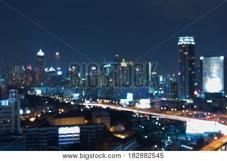 Night blurred bokeh light Bangok city business downtown abstract background