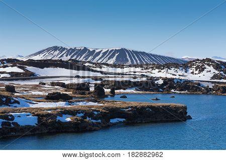 Myvatn volcano over blue lagoon Iceland winter natural landscape background