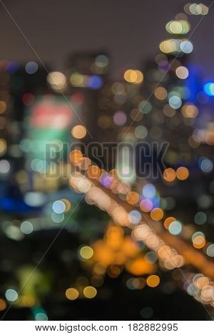 Blurred bokeh light night office building abstract background