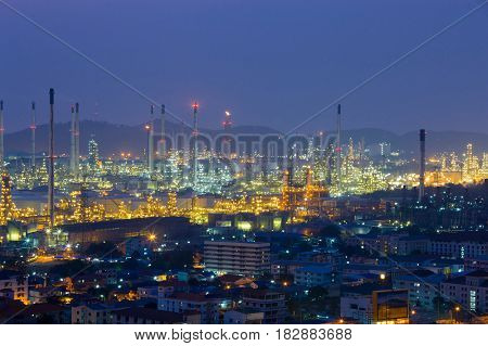 Petrochemical refinery with mountain background night view