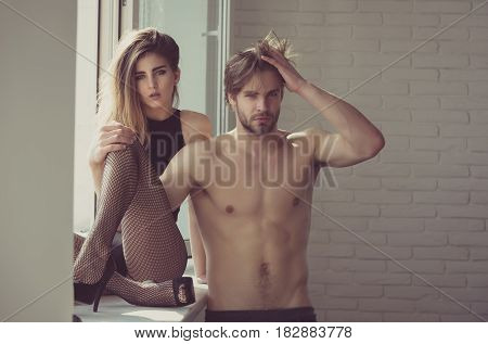 Pretty Sexy Girl Sitting With Legs And Muscular Macho