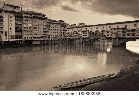 Ponte Vecchio over Arno River in Florence Italy in monochrome.