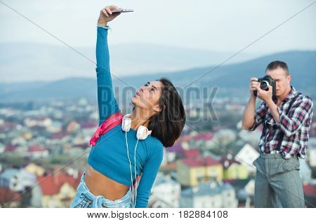 Handsome Man Photographing Pretty Girl Taking Selfie