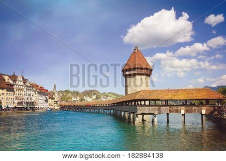 Cityscape of Lucerne with famous Chapel Bridge and lake Lucerne Switzerland. Retro filter effect