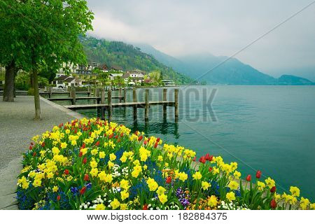 Lake Lucerne Switzerland. Weggis wooden piers with mountains