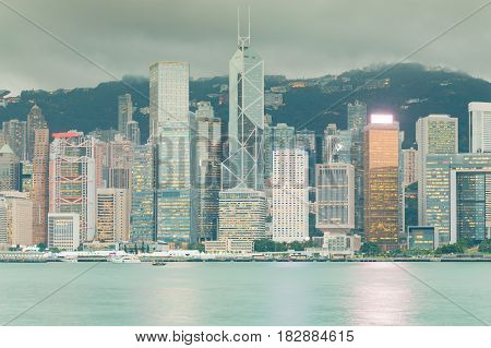 Hong Kong city office building central business area over Victoria bay
