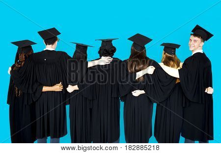 Diverse Students wearing Cap and Gown Studio Portrait