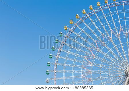 Funfair festival ferris wheel against blue sky background