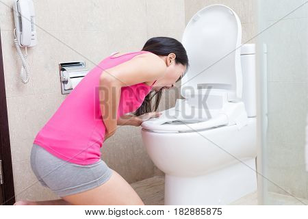 woman are vomiting in the bathroom, asian
