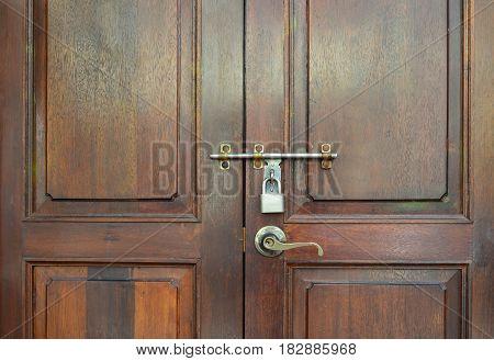 Brown wooden vintage door with lock and handle