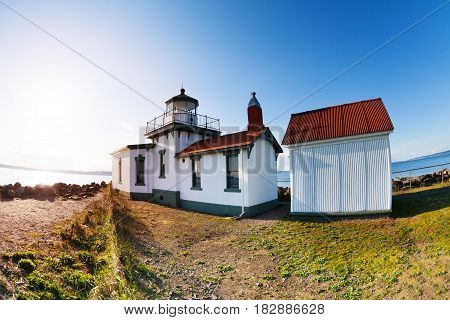 White buildings of West Point Lighthouse at sunny day in Seattle, Washington