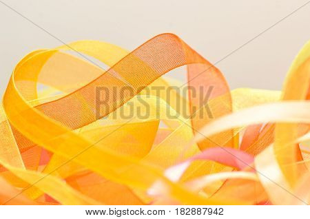 Stripes and ribbons background. Bunch of narrow strips of material. Bright colored curve ribbons tapes.