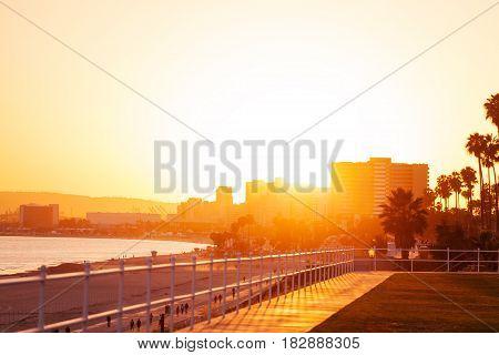 Beautiful sunset over coast and city skyline of Long Beach, California, USA