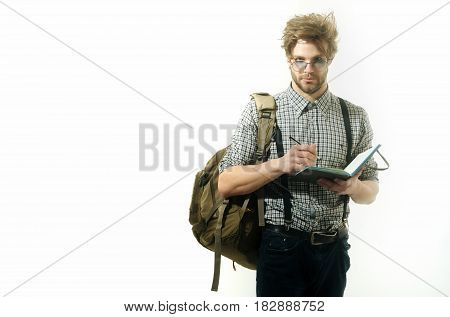 Handsome Man With Traveler Notes In Paper Notebook And Pen