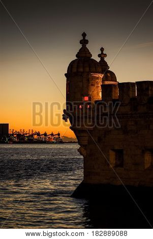 Detail of Belem Tower architecture on river Tagus in Lisbon at sunset light