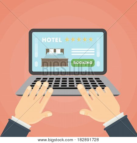 Online hotel booking. Hands typing on the laptop to book a room in the hotel.