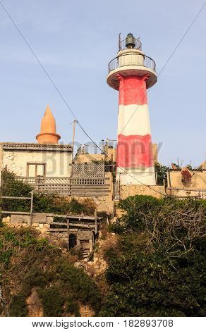 Red and white Old inactive Lighthouse located on a hilltop above the old Jaffa Port Israel Mediterranean vertical view