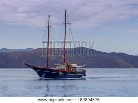 Sailing schooner on the sea road of the port of Athenios. Greece. Santorini.