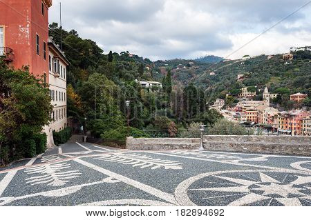 Beautiful square made of small stones at hill of Portofino town, Italy