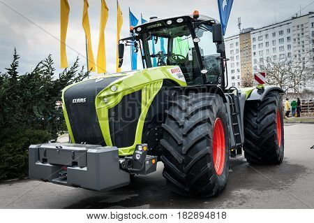 RIGA, LATVIA - APRIL 2017: Claas 5000 tractor and other construction equipment at the public event of Riga Machinery Sales.