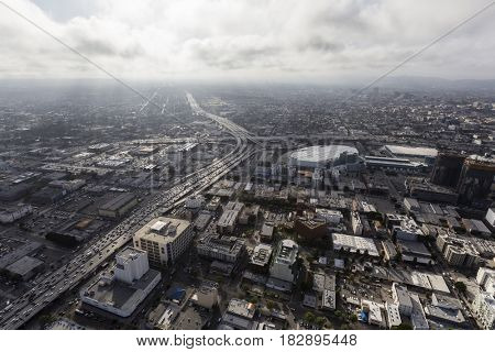 Aerial view of Los Angeles 10 and 110 freeways with afternoon clouds in Southern California.