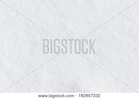 Full frame fresh clean pristine white winter snow background texture viewed as a layer from above