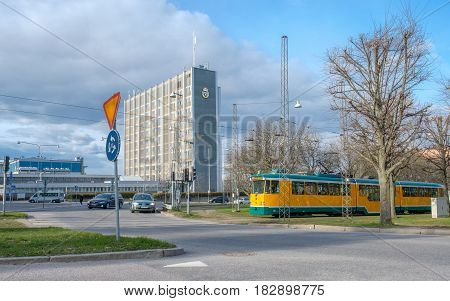 NORRKOPING, SWEDEN - APRIL 19, 2017: Tram passes Norrkoping Police building at the  Northern Promenade. The three Promenades in Norrkoping were inspired by Paris boulevards.