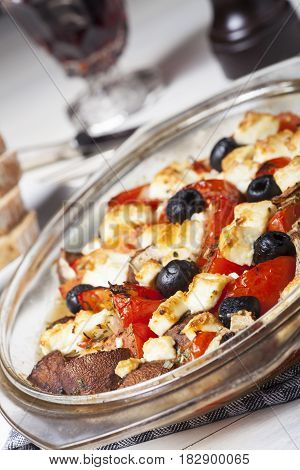 grilled greek feta cheese on glass and wine