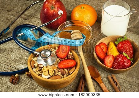 Stethoscope and oatmeal with strawberries. The concept of healthy eating. Diet food
