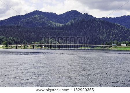 Siberia.View from the water area to the Teletskoye Lake, the bridge and the source of the Biya River