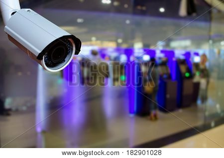 cctv security camera with abstract blurred background of ATM Machine for withdraw or deposit cash money color tone effect security technology concept.