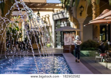 Water feature at outdoor mall with child