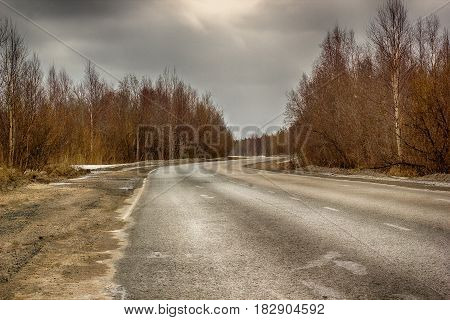 the winding road in cloudy weather spring