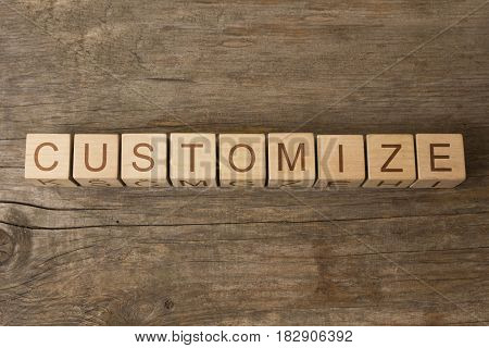 word customize on cubes on wooden background