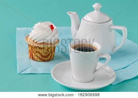 Black Brewed Coffee With Ceramic Utensils And Sweets