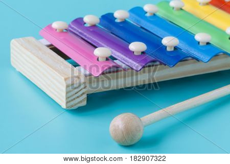 Xylophone Metallophone For Kids with sticks on blue