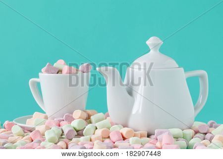 Marshmallow In A Cup On A Light Aquamarine Background.