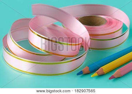 Ribbon Tape And Pen On Aquamarine Background