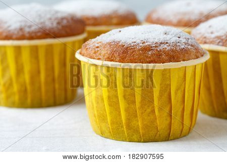 Close-up Of Muffins And Additional Muffins In The Background.
