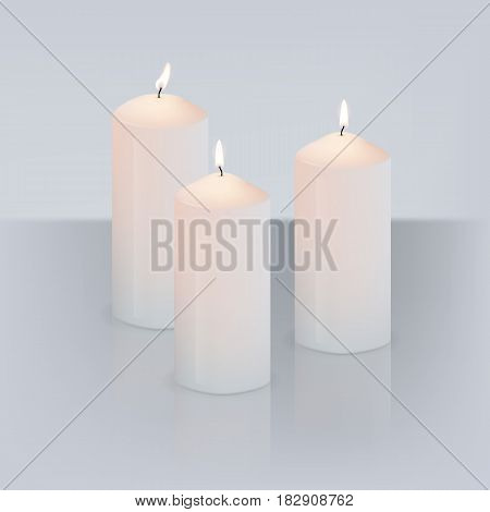 Realistic three candles with fire isolated on grey background with mirror reflection. Vector illustration.