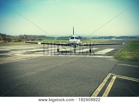 Small private single-engine piston aircraft on runway Small Propeller plane. Piston aircraft at the airport .