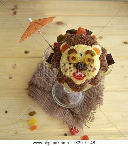 The lion is made of ice cream. A creative dessert for children and good mood.