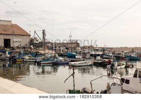 TEL AVIV ISRAEL - May 19 2014: Still functional as a small fishing port - Old Jaffa Port Mediterranean