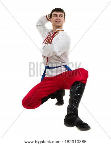young man wearing a folk costume posing against isolated white background with copyspace