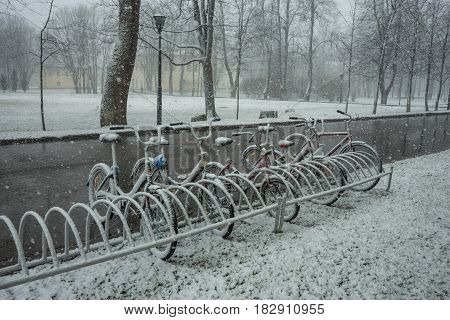 Bicycles Smoothly Covered With Fresh Snow After Weather Phenomena - Snowfall In Late April Near Mosc