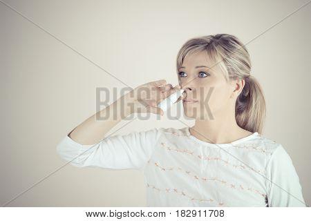 Nasal Spray. Closeup Of Beautiful Young Woman's Face With Nasal Drops.