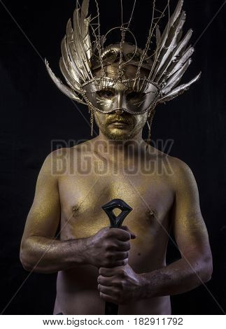 Powerful Golden fantasy warrior, man with sword with gold skin covered